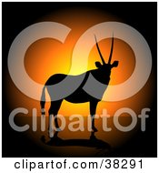 Clipart Illustration Of A Male Antelope With Straight Horns Silhouetted Against An Orange Sunset
