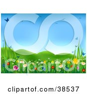Clipart Illustration Of A Lush Green Spring Meadow With Colorful Wild Flowers And Butterflies Under A Blue Sky