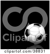 Clipart Illustration Of A Black And White Soccer Ball On A Black Reflective Surface And Background
