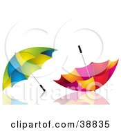Clipart Illustration Of Two Green Yellow And Blue And Red Pink And Yellow Umbrellas On A Reflective White Surface by elaineitalia