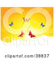 Clipart Illustration Of Five Colorful Butterflies Above The Clouds Against A Sparkling Orange Sunset by elaineitalia