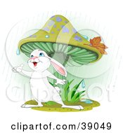 Clipart Illustration Of A Wild White Bunny Rabbit Standing Under A Mushroom Reaching Out To Catch Rain Drops In His Hand by Pushkin