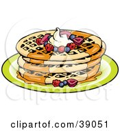 Stack Of Four Round Waffles Garnished With Whipped Cream Maple Syrup And Berries