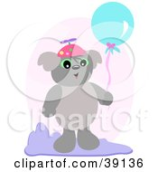 Koala Bear Wearing A Spinner Hat And Holding A Balloon
