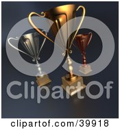 Clipart Illustration Of Tall Trophy Cups In Gold Bronze And Silver