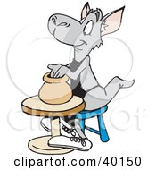 Kangaroo Potter Shaping A Vase Out Of Clay On A Pottery Wheel