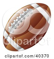 Clipart Illustration Of A Shiny Brown American Football With Stitches And Stripes by AtStockIllustration