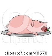 Roasted Pink Pig With An Apple In Its Mouth Served On A Platter
