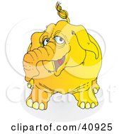 Clipart Illustration Of A Playful Yellow Elephant by Snowy