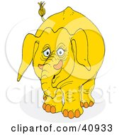 Clipart Illustration Of A Sad Yellow Elephant by Snowy