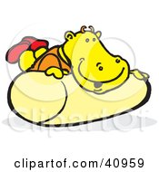Clipart Illustration Of A Yellow Hippo Playing On A Roll by Snowy