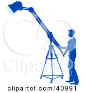 Clipart Illustration Of A Blue Silhouetted Spotlight Technician Working In A Studio