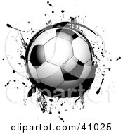 Clipart Illustration Of A Shiny Soccer Ball On Black Grunge by elaineitalia