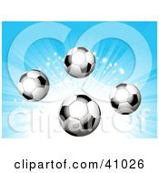 Soccer Balls On A Bursting And Sparkling Blue Background