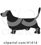Clipart Illustration Of A Black Silhouetted Basset Hound Dog Profile by Prawny
