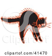 Clipart Illustration Of A Black And Red Frightened Cat Arching Its Back