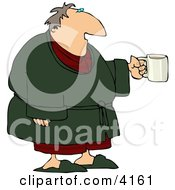 Tired Man Wearing A Bathrobe And Holding A Cup Of Coffee During The Early Morning Of His Day