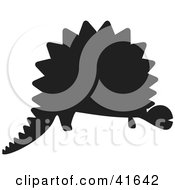 Clipart Illustration Of A Black Silhouetted Dinosaur