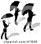Clipart Illustration Of Three Black Silhouetted Women Standing With Umbrellas by dero