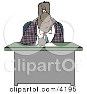Ethnic Businessman Writing On Papers At His Office Desk Clipart