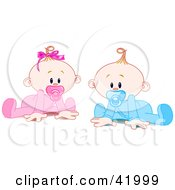 Twin Baby Boy And Girl With Pacifiers Trying To Crawl