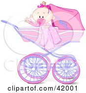 Waving Baby Girl With A Blanket And Pacifier In A Carriage
