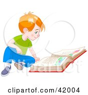 Red Haired Little Boy Sitting On The Floor And Reading A Story Book