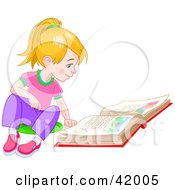 Blond Little Girl Sitting On The Floor And Reading A Story Book