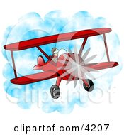 Male Pilot Flying A Red Biplane