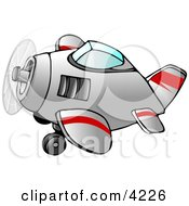 Propelled Airplane In Flight Clipart