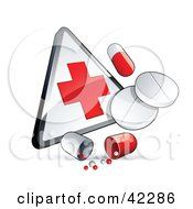 Pills And Capsules With A First Aid Sign
