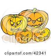 Clipart Illustration Of Glowing Carved Halloween Pumpkins With Fangs And Evil Eyes