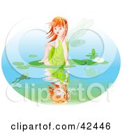 Red Haired Fairy Girl Sitting On A Lily Pad On A Pond