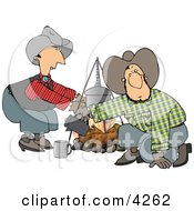 Cowboy And Cowgirl Beside A Campfire Clipart