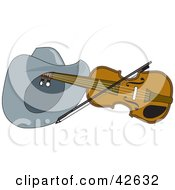Clipart Illustration Of A Cowboy Hat Resting On A Violin With A Bow
