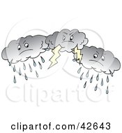 Clipart Illustration Of Three Dark Rain And Lightning Storm Clouds