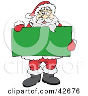 Santa Holding A Blank Green Sign