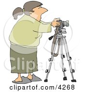 Freelance Photographer Taking Photographs With Digital Camera Mounted To A Tripod Clipart
