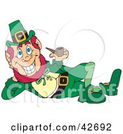 Clipart Illustration Of A Jolly Leprechaun Laying On His Side And Smoking A Pipe