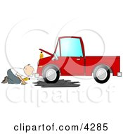Man Trying To Give A Red Truck An Oil Change