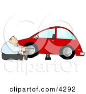 Businessman Changing A Flat Tire Clipart