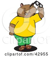 Clipart Illustration Of A Squinting Wombat Holding Glasses by Dennis Holmes Designs