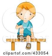 Boy Bandaging His Hurt Knee
