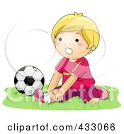 Royalty Free RF Clipart Illustration Of A Boy Stretching By A Soccer Ball by BNP Design Studio