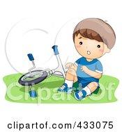 Boy With A Hurt Knee Sitting By A Bike
