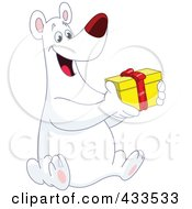 Royalty Free RF Clipart Illustration Of A Happy Polar Bear Holding A Christmas Gift by yayayoyo