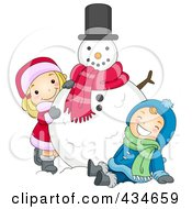Boy And Girl Playing With A Snowman