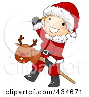 Christmas Boy In A Santa Suit Playing With A Stick Pony