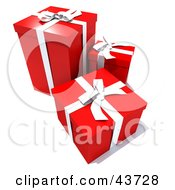 Three Red Gift Boxes With White Ribbons And Bows
