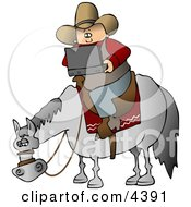 Cowboy Using A Portable Wireless Laptop Computer While Sitting On A Saddled Horse Clipart